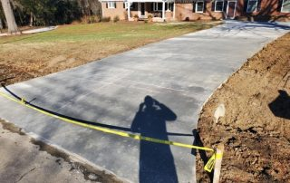 picture of a new concrete driveway poured for a customer.