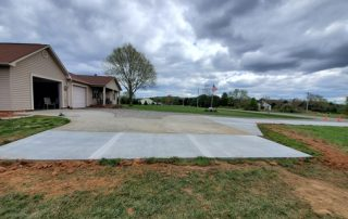Picture of a driveway and pad concrete extension added.